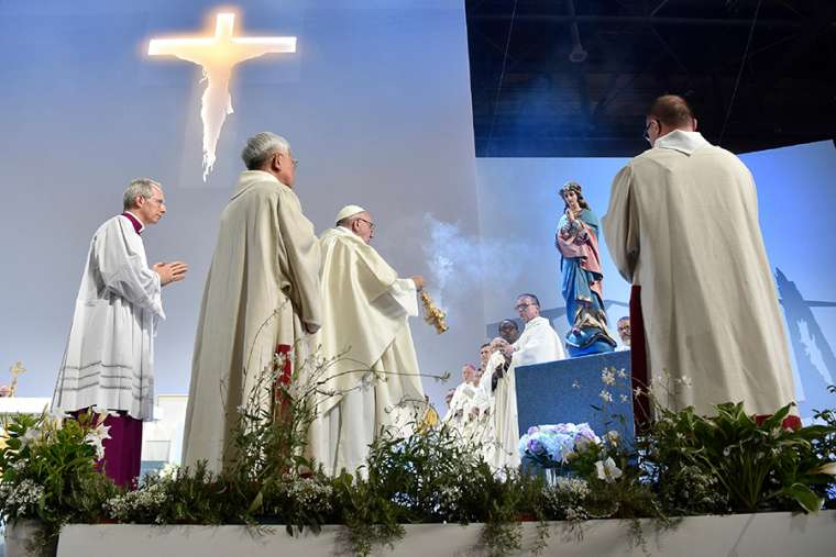 Pope Francis presiding at a  Novus Ordo  Mass in Geneva June 21, 2018 Credit Vatican Media. Editor's Note: I have no idea what the burning crucifix is all about but such an image used to be easily recognized as the symbol of the Klu Klux Klan.  Bizarre!
