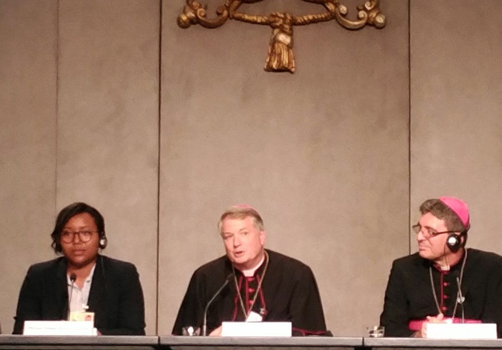 Archbishop Anthony Fisher, center, responding to my question.