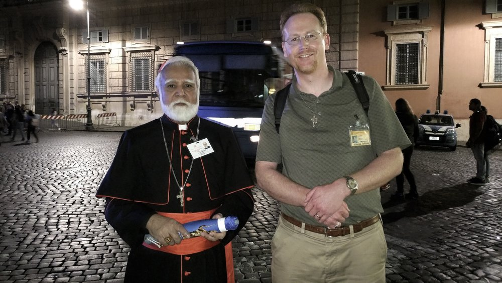 "His Eminence Cardinal Joseph Coutts (Archbishop of Karachi in Pakistan) with CFN Managing Editor Matt Gaspers after the Meeting of Young People (aka ""Saturday Night Circus"")."