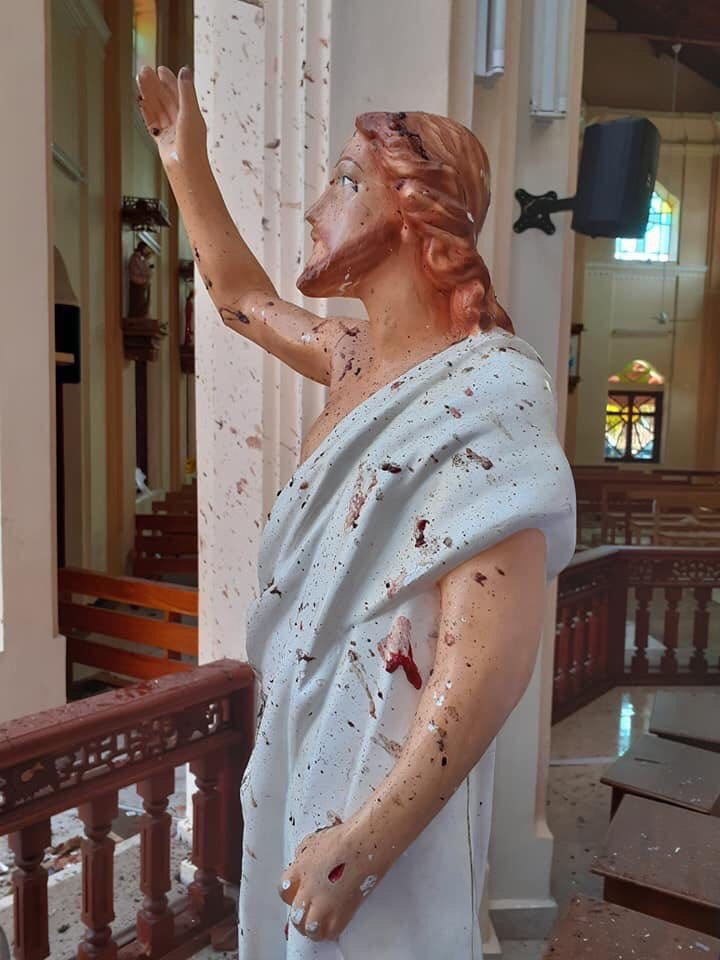 This statue of Our Lord, located in St. Sebastian's Church in Negombo, Sri Lanka, is stained with the blood of Catholic victims murdered during Easter Mass (Apr. 21, 2019).